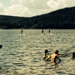 arrowhead students swimming and paddleboarding